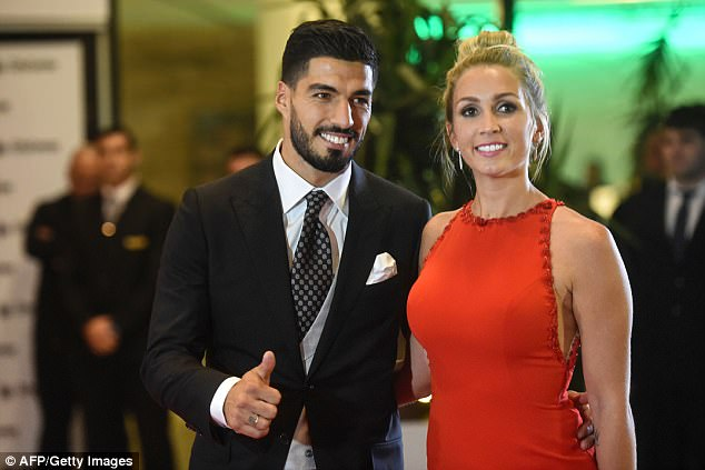 Luis Suarez and his wife Sofia Balbi flash smiles to the camera having attended the wedding