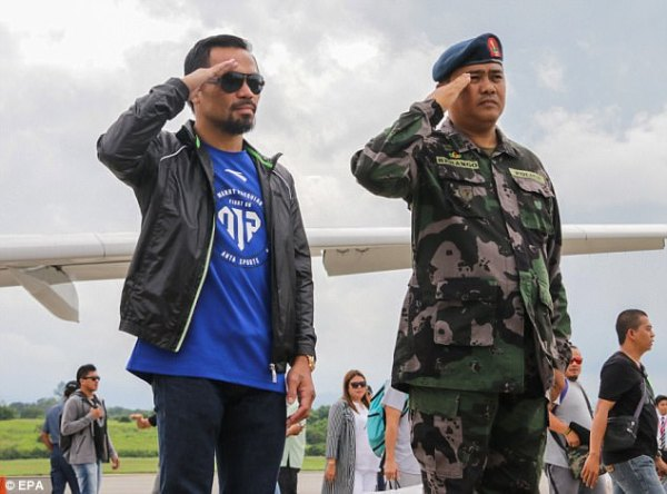 Manny Pacquiao given a military guard of honour back home ...