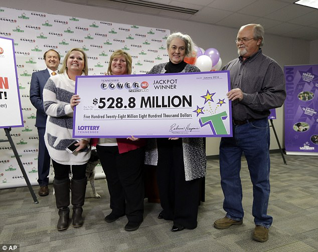 John and Lisa Robinson immediately claimed their prize and even went on the Today show before they turned in their winning ticket to lottery organizers (John, right, Lisa, second left)