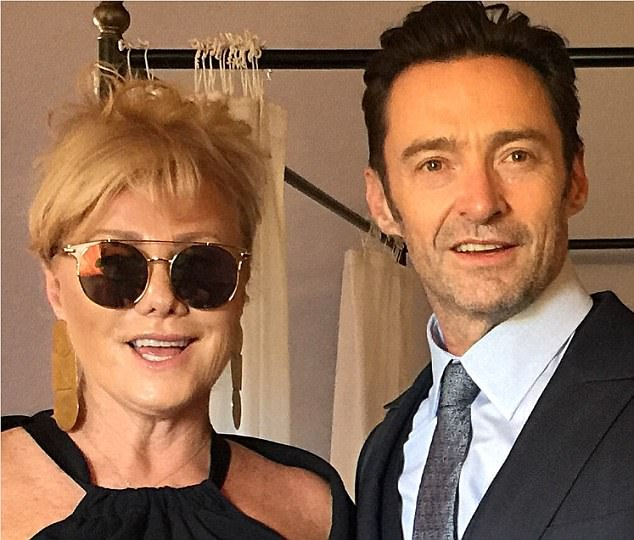 Loved up: Hugh Jackman proved his love for wife Deborra-Lee Furness was stronger than ever on Monday night, dressing to the nines and enjoying a date night