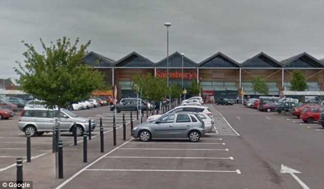 Car park: Shoppers were outraged after a five-month old crying baby was left locked inside a hot car outside this Sainsbury's supermarket (above) in Gloucester on Sunday afternoon