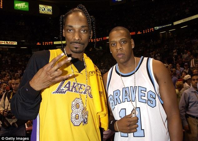 Jay-Z and Snoop Dogg at a basketball ball game