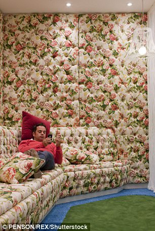 Pictured: A Google worker relaxes in the 'Snug-lushness' seating area at the company's Covent Garden HQ