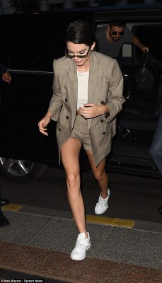 Suited and booted: Kendall Jenner and Bella Hadid were ready to hit the town on Wednesday night after the Fendi show, both sporting cool and quirky checked ensembles