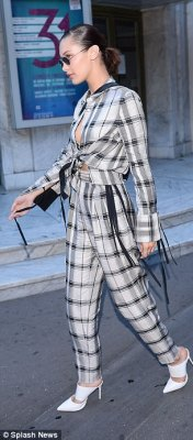 Fancy footwear: Her look boasted a fashionable twist thanks to statement white heels and a pair of round shades