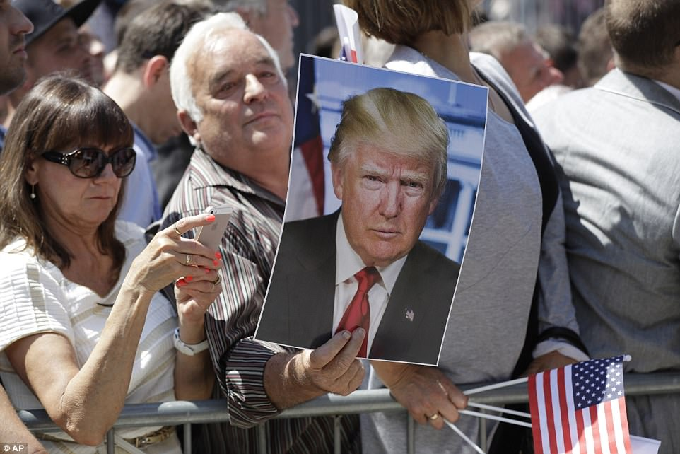 One man kept his supportive sign straight and to the point: He simply carried around a photo of President Donald Trump to the rally