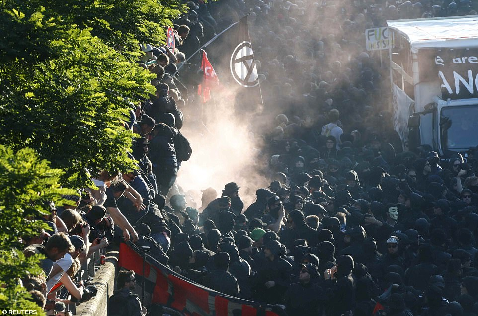 Pictured: Protesters using smoke bombs during the demonstrations during in northern Germany