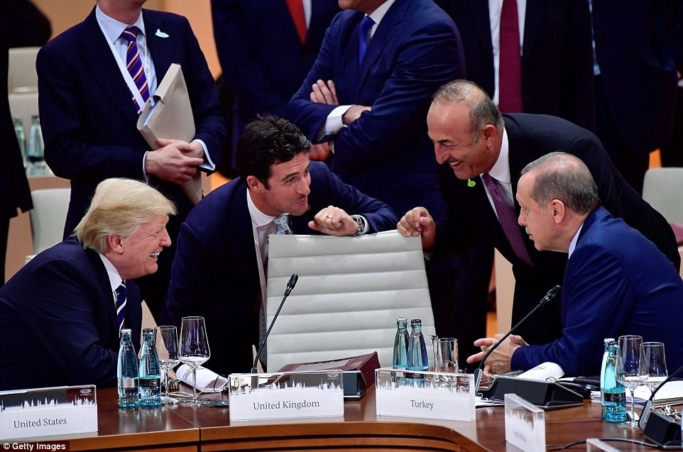 Trump talks to the President of Turkey Recep Tayyip Erdogan (right) and others before the beginning of first working session of the G20 Nations Summit