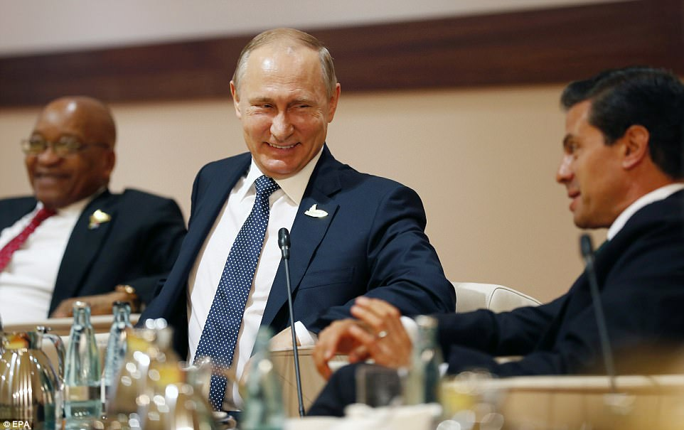Putin laughed as he spoke with Mexico's President Enrique Pena Nieto as South African President Jacob Zuma sits nearby during a talk at the G20 Summit