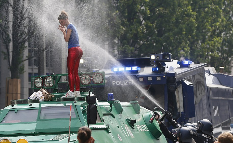 Hamburg police say they have used a water cannon to clear a blockade by protesters ahead of the opening of the Group of 20 summit