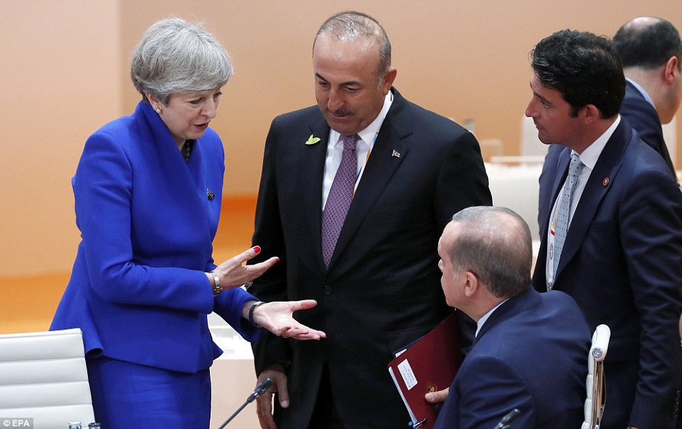 May (left) chats with Turkish President Recep Tayip Erdogan (second right) and Turkish Foreign Minister Mevlut Cavusoglu (second left) at the beginning of the plenary session