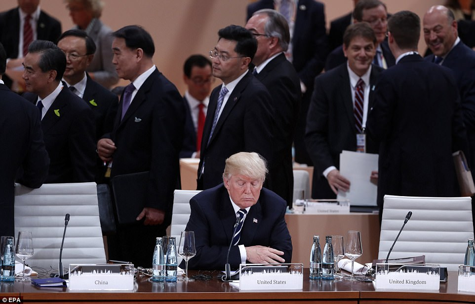 Image result for trump sitting alone at g20