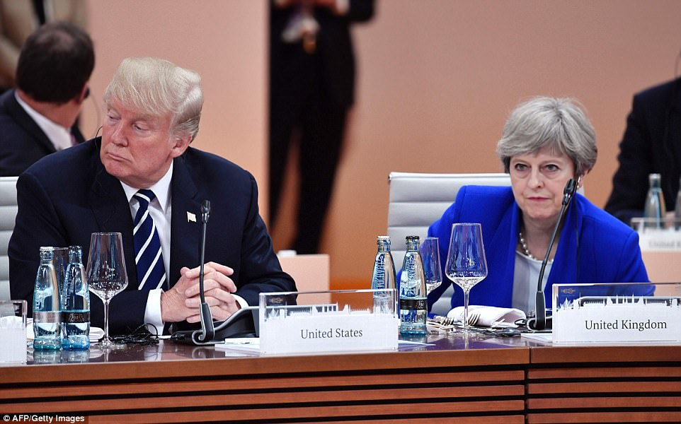 Trump sat next to Britain's Prime Minister Theresa May as they prepped to start the first working session of the G20 meeting