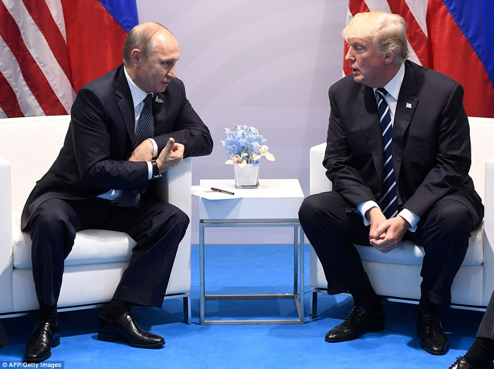 The pair spoke briefly to the press before starting their meeting, and Trump said that he was looking forward to some 'positive talks' with Putin