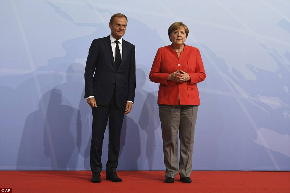 Merkel welcomes the president of the European council, Donald Tusk at the G-20 summit in Hamburg on Friday. Tusk held a joint press conference with Japan's Abe and fellow EU institutional chief Jean-Claude Juncker before the event