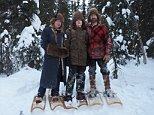 David (right) and Romey Atchley (left) and their son Sky (centre) are the only people living along their 250-mile stretch of the Nowitna River in central Alaska