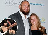 UFC star Travis Browne has revealed how he tracked down the burglars that raided his and girlfriend Ronda Rousey's home (pictured in April in Beverly Hills)
