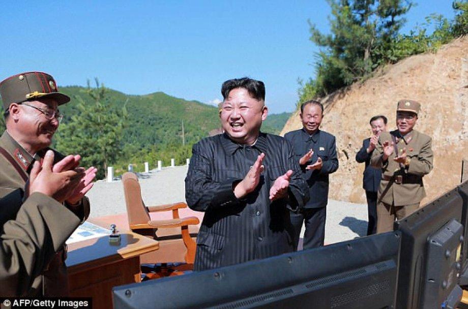 Image result for KIM UN enjoys with ICBM