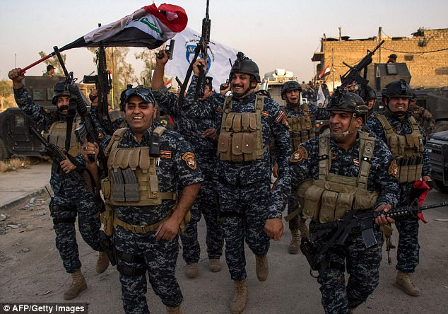 Iraq's Prime Minister Haider al-Abadi declared 'total victory' in the city on Monday, but clashes along the edge of the Old City continued into the evening Tuesda