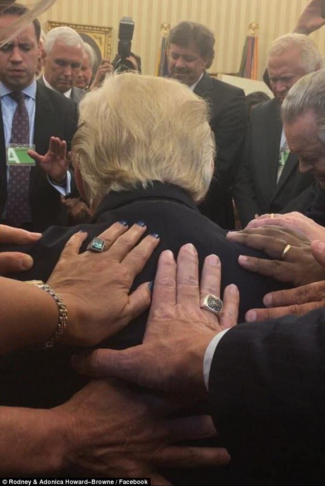 Evangelical pastor Rodney Howard-Browne posted this image of himself and wifeAdonica leading prayers over President Trump on Monday as people laid their hands on him