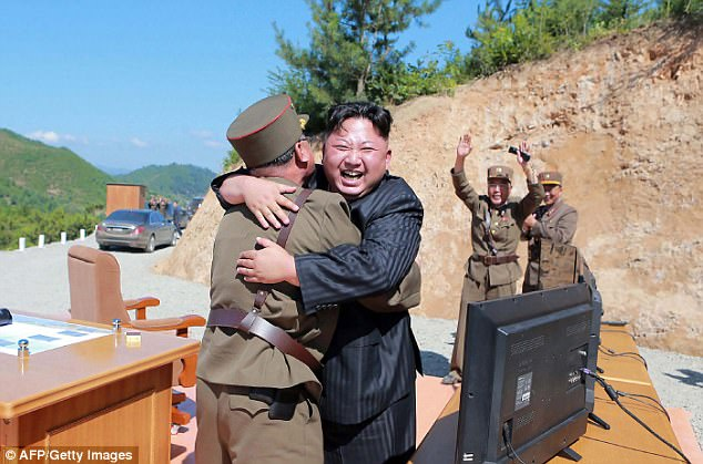 North Korean leader Kim Jong-Un (centre) celebrating the successful test-fire of the intercontinental ballistic missile Hwasong-14 at an undisclosed location on July 4