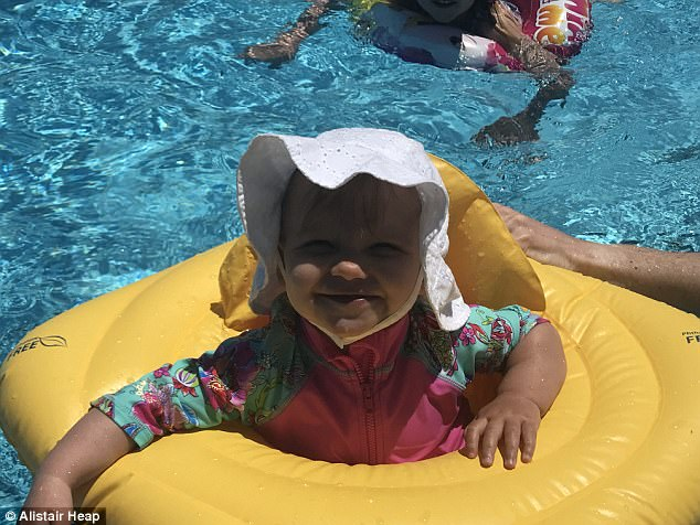 ¿I cover her in a sun suit and hat and make sure she¿s not in the sun when it¿s hottest' (Pictured: Stephanie's younger daughter Aurelia, one, on holiday in Greece)