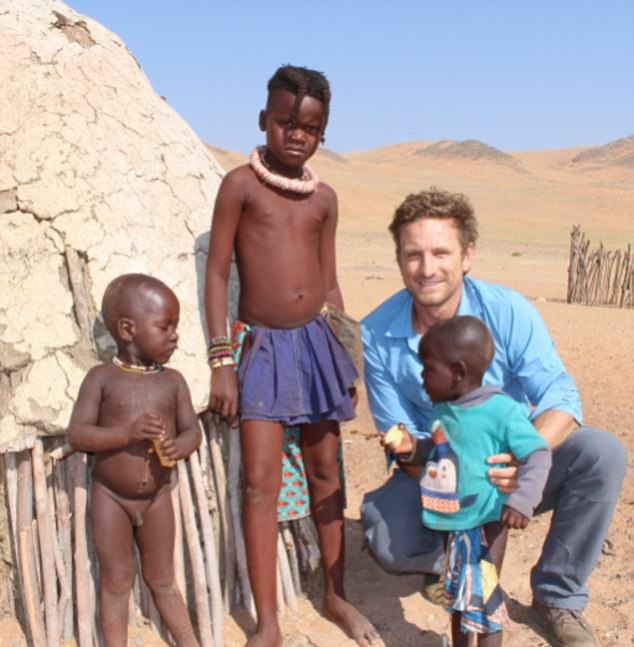 The glowing mother-to-be also shared snaps of her beaming fiance playing with some of the local children as they made their way around northern Namibia