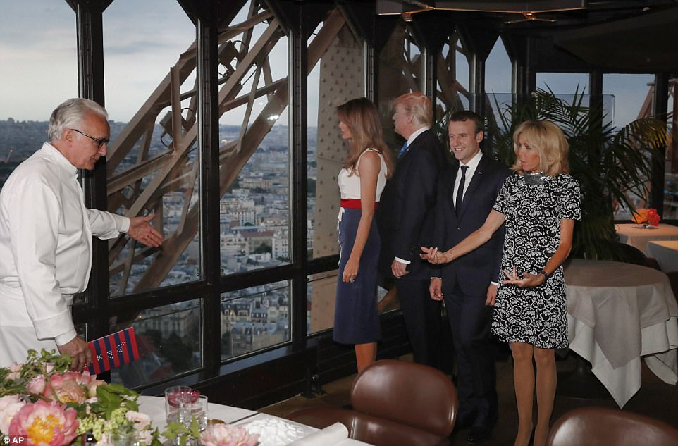 French chef Alain Ducasse, left, gestures the presidents and their wives to their table at his Jules Verne restaurant at the Eiffel Tower in Paris, France