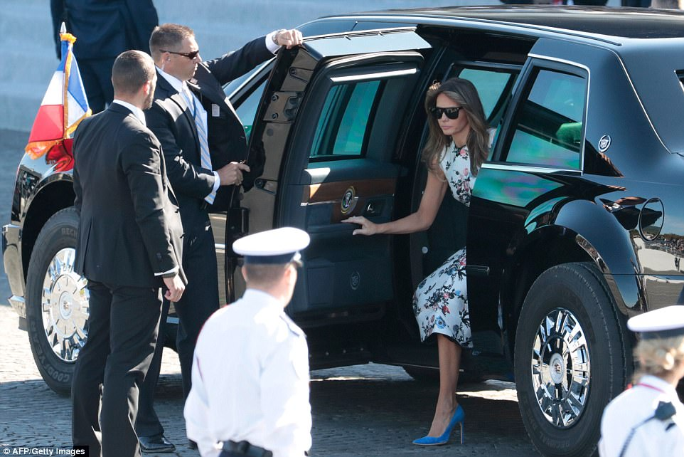 Melania Trump is seen arriving at the celebration in the presidential limo this morning. The first lady wore a light blue, floral print dress and baby blue pumps to the mid-morning event