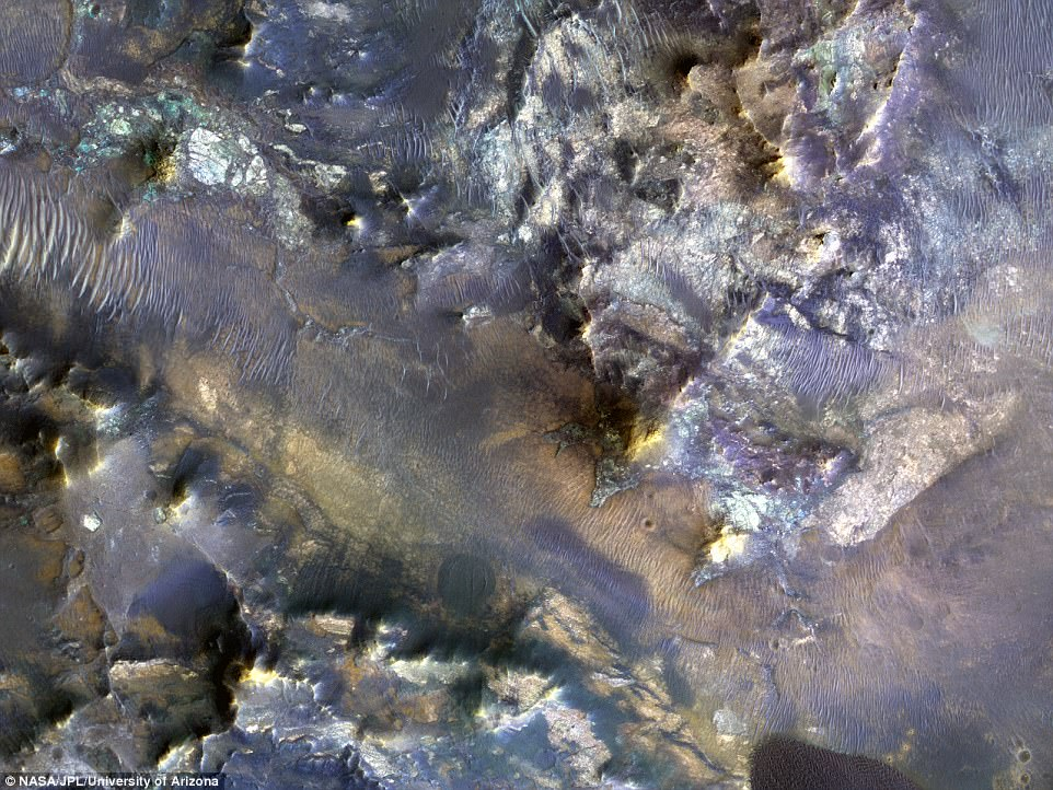 The experts say the features seen in this unnamed crater in Mars' Mare Serpentis region are similar to those seen elsewhere, and can help to shed light on the subsurface materials kicked up after an impact