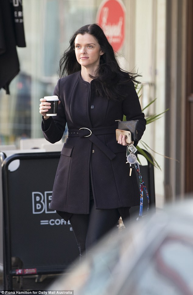 Amber Harrison was pictured out and about on Monday morning - hours before a Supreme Court Justice hands down his decision on whether she should pay Seven's court costs