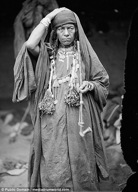 A Bedouin woman of the Adwan tribe is pictured holding a pipe east of the River Jordan between 1898 and 1914