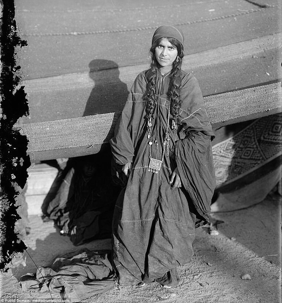 Many of the tribes ceased living in the deserts as the oil fields which lay beneath were being farmed by Britain and America, bringing the Bedouin material prosperity and into contact with the comforts and technology of the modern world. A Bedouin woman is pictured between 1898 and 1914
