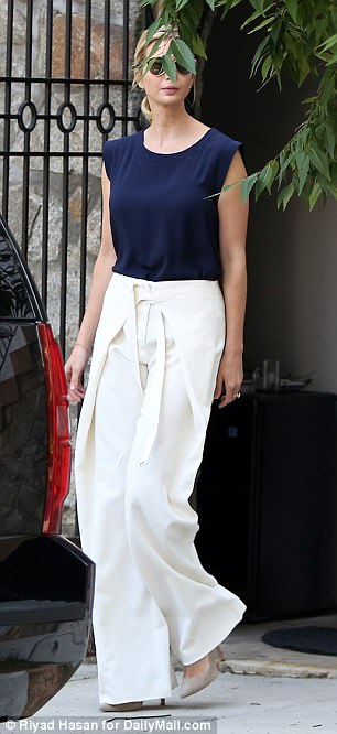 Chic as can be: Ivanka paired her $1,440 Proenza Schouler trousers with a navy T-shirt, nude heels, and a pair of Dior So Real sunglasses