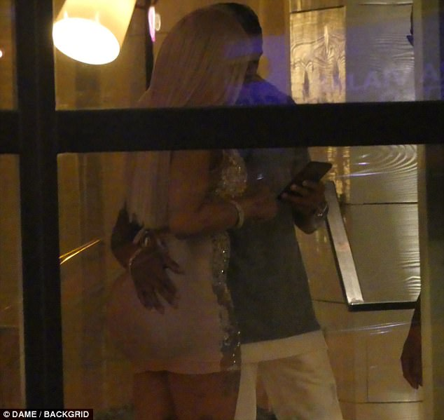 Smooch: Blac Chyna put on a very public display of affection with the 24-year-old after they hit up a club