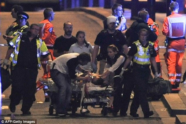 Police and members of the emergency services attend to victims of the terror attack on London Bridge in central London on June 3 in which armed police opened fire during