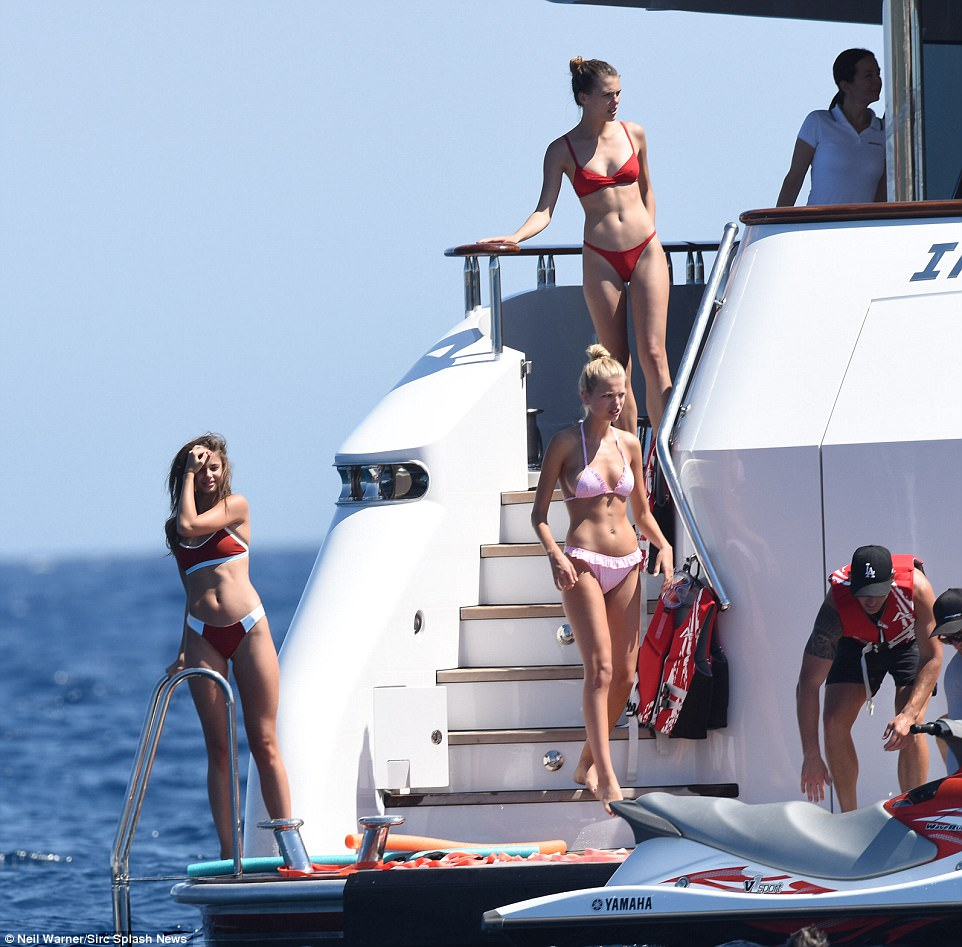 The ladies: It was battle of the bikinis on the yacht as the girls larked around playing an array of watersports