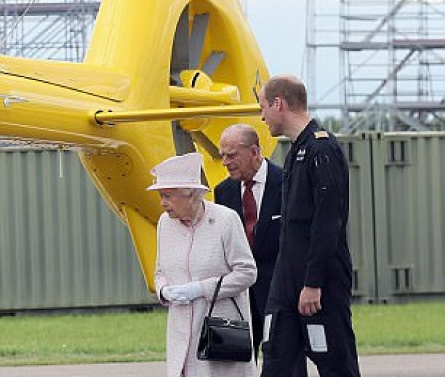 Proud Grandparents The Queen And Prince Philip Stand With William Near The Eaaa Helicopter