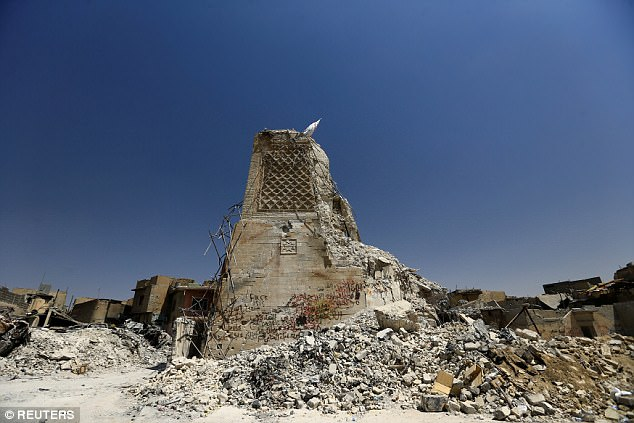 The destroyed al-Hadba minaret at the Grand al-Nuri Mosque is seen in the Old City of Mosul, Iraq.After the liberation, the army officer and his comrades were told by their superiors 'to kill anything or anyone that moved', which included Mosul's desperate citizens who have lived through the terror of ISIS' reign