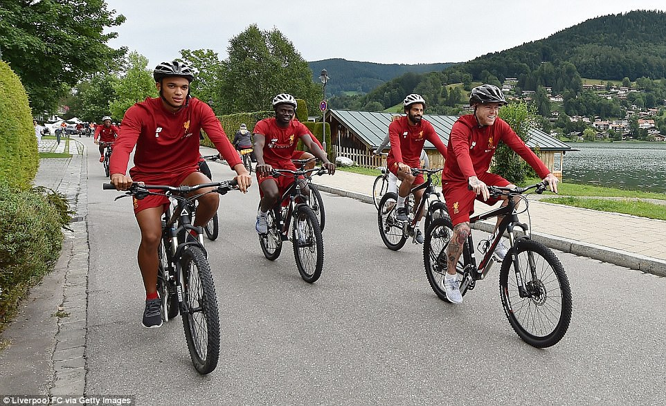 Liverpool players (from left) Trent Alexander-Arnold, Sadio Mane, Mohamed Salah and Alberto Moreno on their bikes