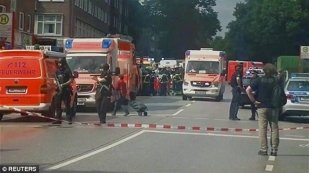 Security forces and ambulances descended on the scene after the a knife attack in a supermarket in Hamburg