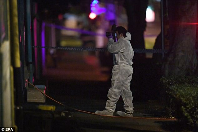 Forensic teams (pictured) and the bomb squad attended the scene during the Surry Hills (pictured) raid