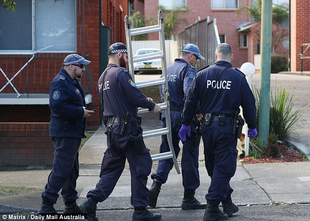 Police are seen continuing their investigations in the aftermath of the Sydney terror raids