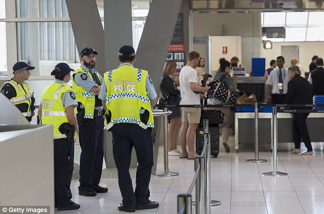 Police standing by at Sydney Airport on Sunday following the dramatic raids on Saturday afternoon