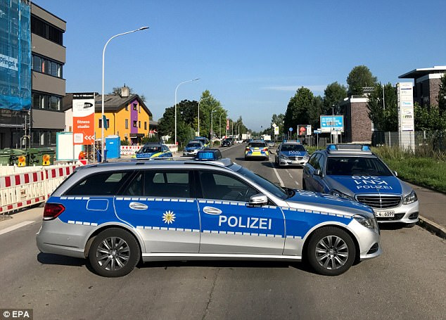 Two people have died and three others are fighting for their lives after a man armed with a machine gun opened fire in a packed German nightclub, according to reports. Police are pictured at the scene