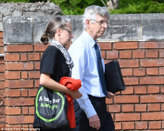 Turner (pictured ay court with his daughter) said the doll was a 'companion' for him and his wife. He will be sentenced next month following the first-of-its-kind ruling today