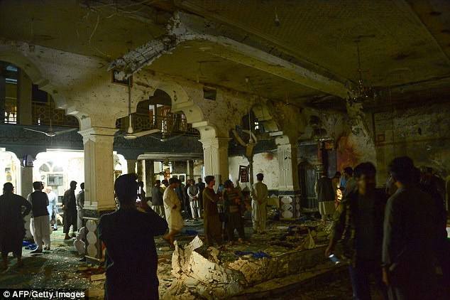 A suicide bomber and a gunman killed more than 20 people at a Shiite mosque in Afghanistan's main western city of Herat on August 1