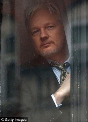 Wikileaks founder Julian Assange prepares to speak from the balcony of the Ecuadorian embassy (stock photo)