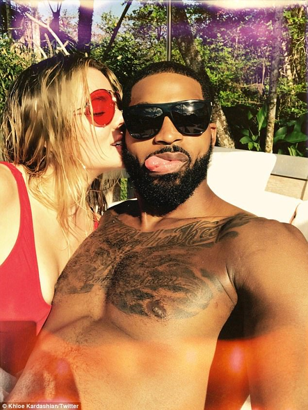 'All my Love': Khloe Kardashian pressed her lips to her shirtless boyfriend Tristan Thompson's cheek in a photo she posted to Instagram this Sunday