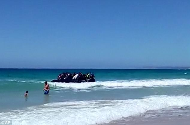 New arrivals: A video filmed by a witness show the dinghy pulling into shallow water at Cadiz